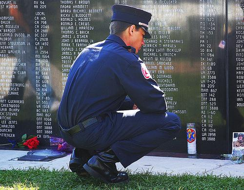 A man pays his respects at the fallen fire fighter memorial in Colorado Springs