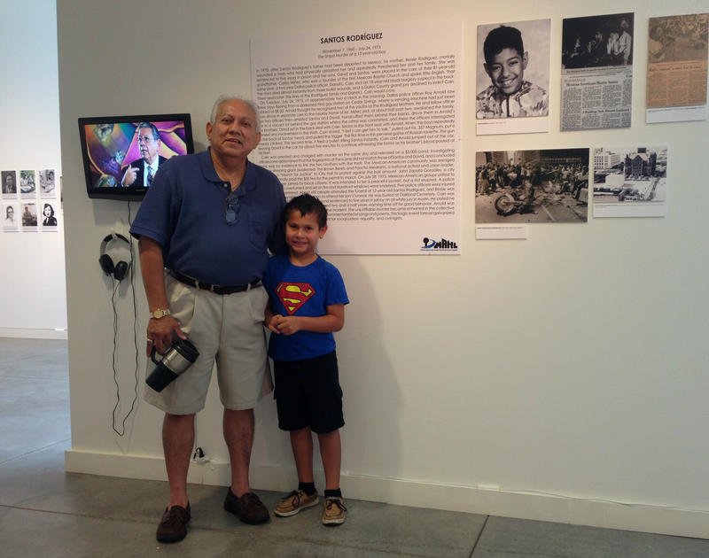 "Albert Valtierra, president of the Dallas Mexican American Historical League, with his grandson, Gabriel, at the Latino Cultural Center's ""Justicia"" exhibit."