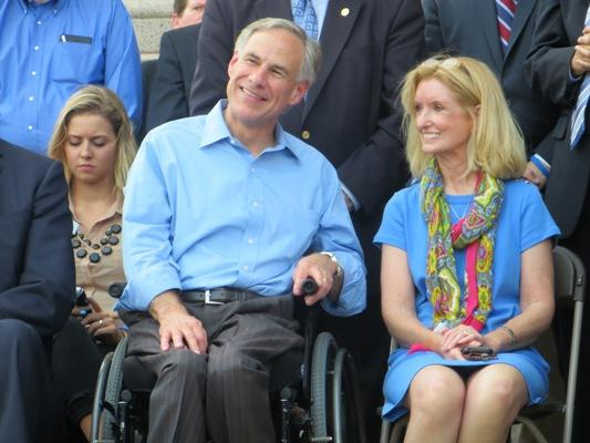 Texas Attorney General Greg Abbott (left, with state Rep. Jodie Laubenberg) has been in a wheelchair since age 26.