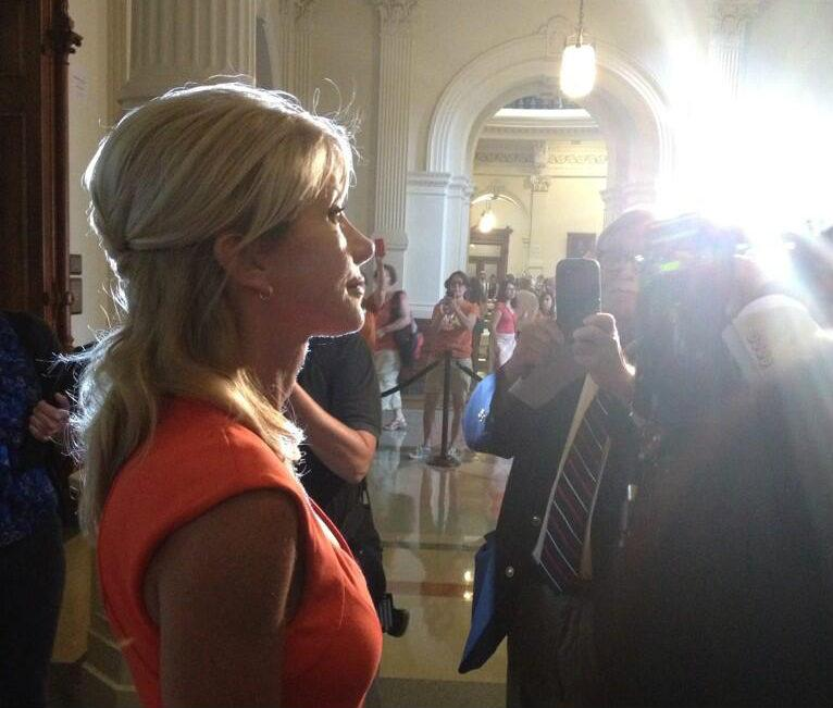 Texas Sen. Wendy Davis (D-Fort Worth) gets ready for her close-up during Tuesday's protests in Austin.