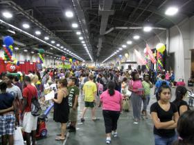 A busy, 2012 Dallas Mayor's Back to School Fair in one of two large Fair Park buildings that contain it.  It'll be in Fair Park again.