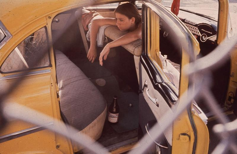 A teenager parks in El Paso's Second Ward in  June of 1972. (Danny Lyon/NARA)
