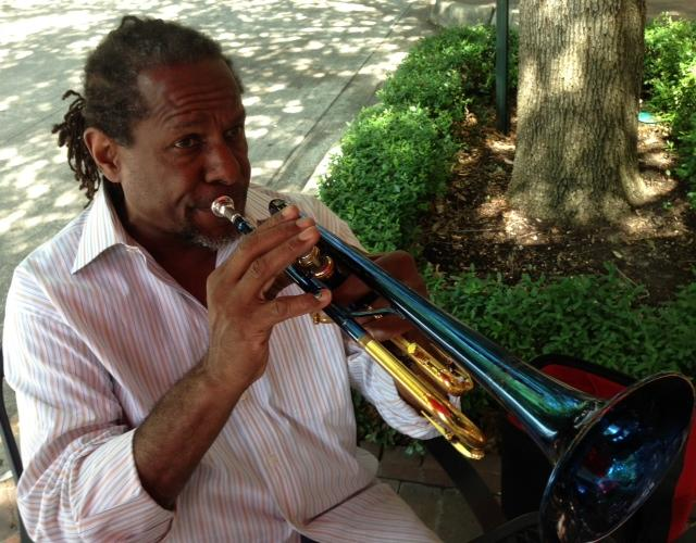 Freddie Jones plays some impromptu jazz outside a coffee shop on Addison Circle.