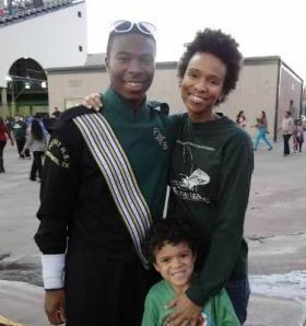 Andrea Estrada with her two sons, Dashon Moore-Guidry (left) and Gabriel.