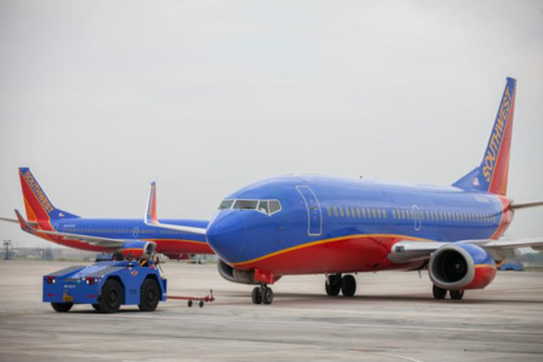 Dallas-based Southwest Airlines Co. said Thursday that first-quarter net income tripled from a year ago, to a record $453 million.