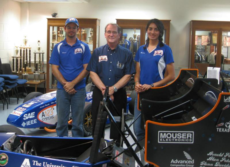 J.P. Merkel, Dr. Bob Woods, Captain Naima Rivas, in front of this year's mini Indy car