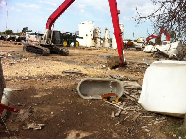 Clean up continues at the fertilizer plant site less than a mile from West High School, and the middle school