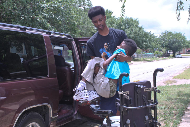 Older brother Robert has been instrumental in Chance's care. He gets him up every morning and helps him in and out of the family van.