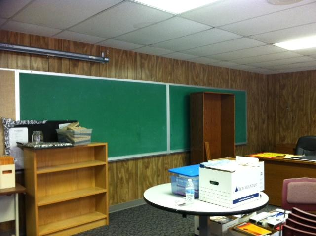 Inside a portable classroom: getting ready to welcome students.