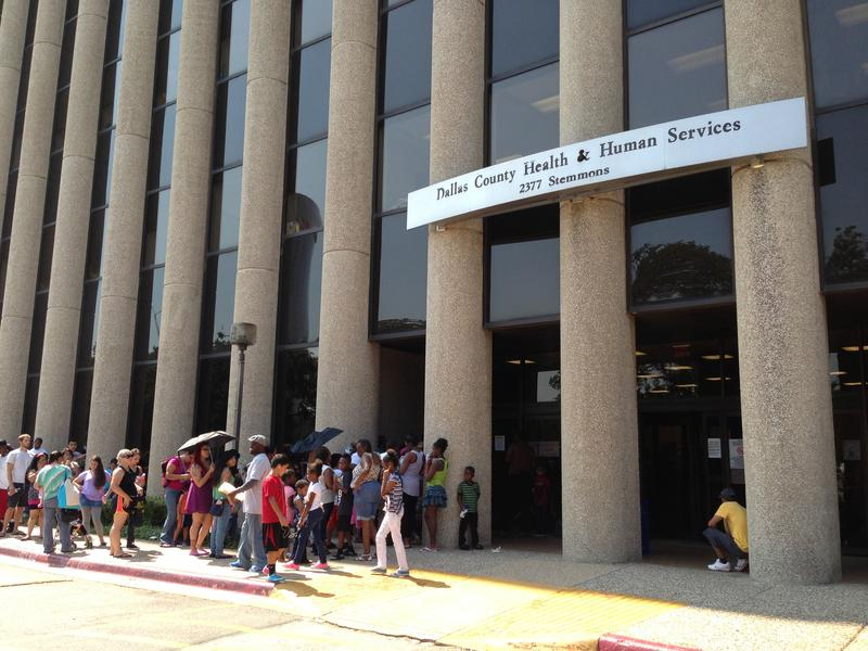 Parents and kids endured the hot afternoon as they waited outside the Dallas County health department. School starts Monday and kids have to be up to date on all of their shots.