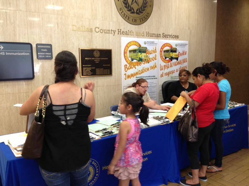 Dallas County health department workers helped parents fill out paperwork. Parents must have their children's immunization records before they can have them vaccinated.