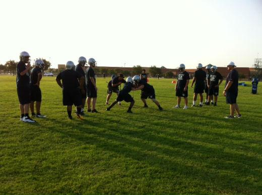 Ranchview High School players busy with pre-season drills on the practice field.