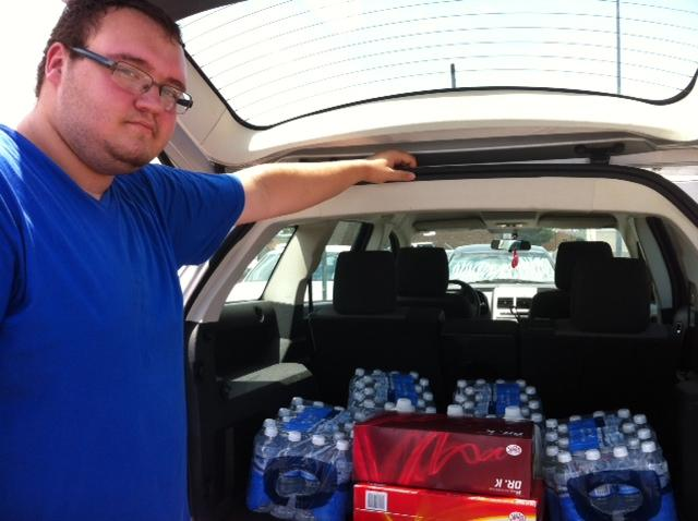 Troy Swinney of Grand Prairie stocked up on water after officials warned the city might run out of water because of a major pipeline break.