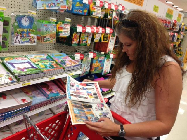 Cheryl Yarbrough checks her Target coupon book for items her three children need this year.