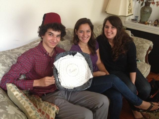 Ibrahim El-Rayes holds the platter from which 50 Chick-n Minis disappeared Thursday morning, with his cousins Laila and Dalia Abdelghani.
