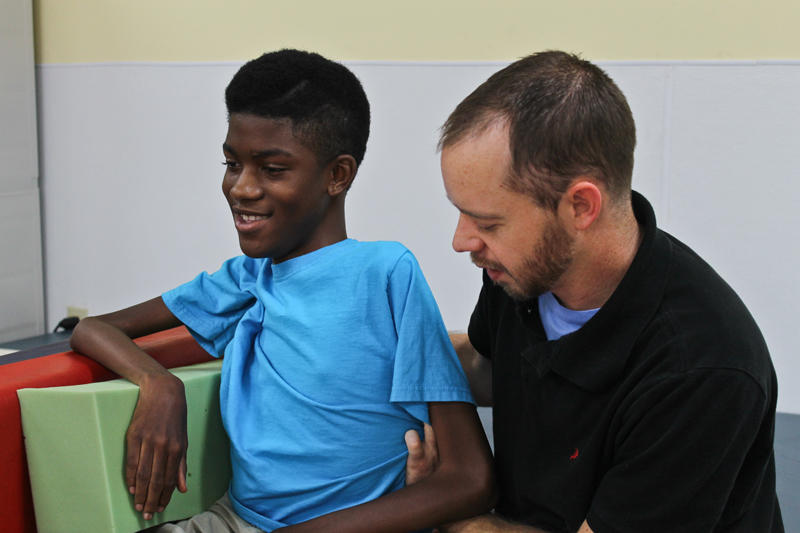 Physical therapist Nathan Morgan works with Chance Hawkins at a pediatric rehab facility in Fort Worth. Chance, 15, was born with Duchenne muscular dystrophy, a rare genetic disorder that affects 1 in 3,600 male infants.