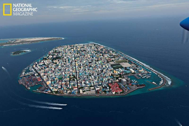 A seawall now protects Maale, capital of the Maldives, an Indian Ocean archipelago that is the lowest, flattest country on Earth. By 2100 rising seas may force Maldivians to abandon their home. More than 100,000 live on this island.