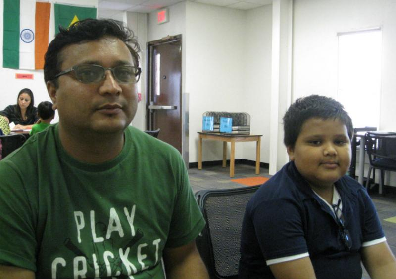 Saroz Kafley and son Ayush, at DISD's Intake Center. They came here 5 months ago from a Nepalese refugee camp.