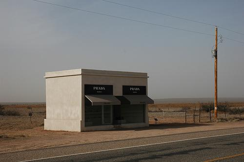 The shack-sized Prada Marfa was installed in 2005. It resembles a storefront of the high-end Italian fashion brand.