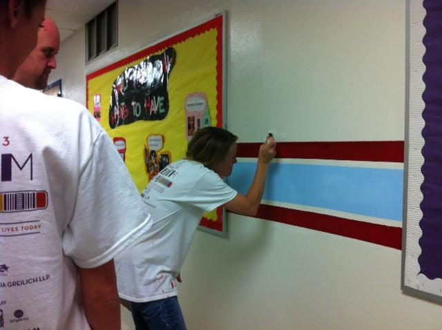 Atwell Middle School's newly painted walls get an extra touch in school colors.
