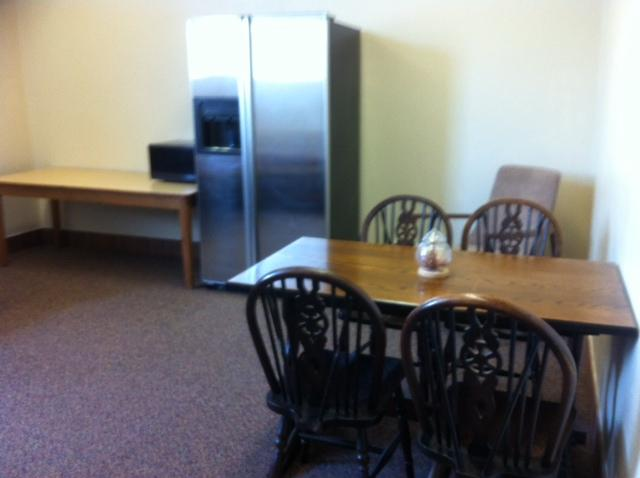 New carpet, furniture and 'fridge in one of the five teacher lounges that got makeovers.