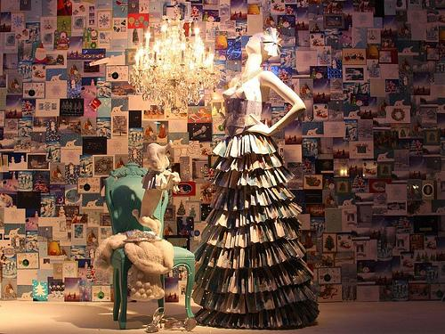 A Neiman holiday window from 2008, featuring a dress made from folding cards.