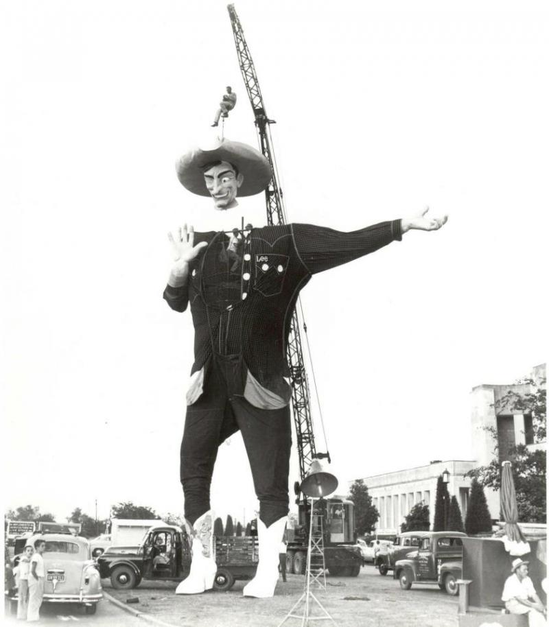 The State Fair bought the Kerens Santa in 1951 and transformed him into Big Tex for the 1952 fair. Here he is being installed the first time at Fair Park.