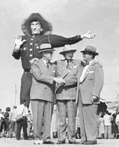 R.L. Thornton, center, was the State Fair president and future Dallas mayor who is credited with the Big Tex concept.