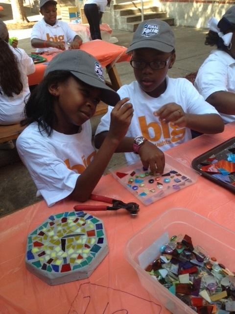 Students at Rice check out recycled glass for stepping stones.