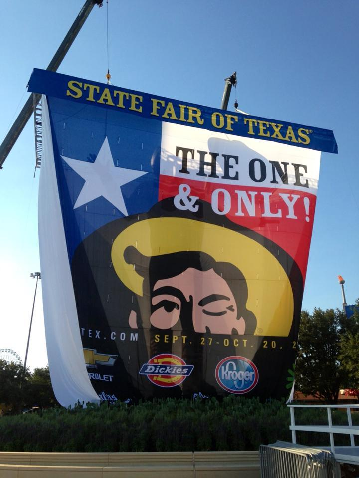 Peekaboo! Big Tex is hiding behind this massive curtain, ready for his Friday debut.