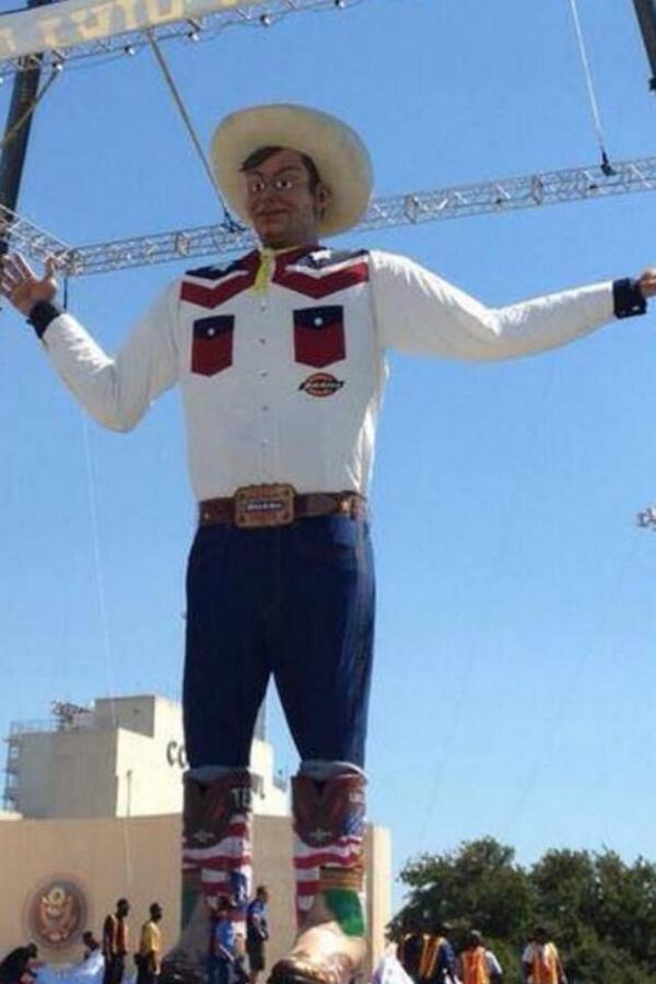 Big Tex has fancy new boots covered with classic Texas symbols.