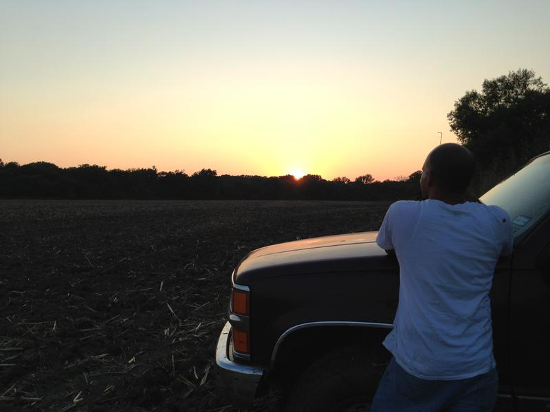 After a long day looking for hogs in Southeast Dallas, Osvaldo Rojas takes in the sunset.