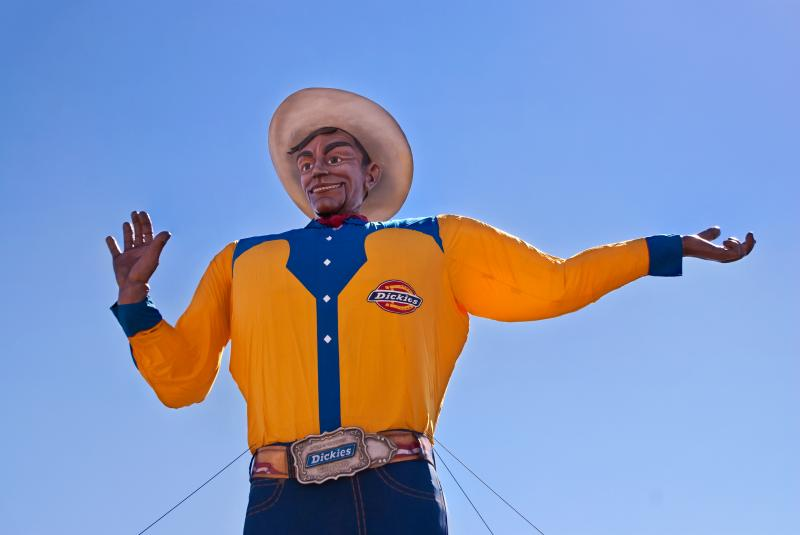 Big Tex's look has evolved through the years. Take a look. Big Tex got his bright canary yellow shirt in 2008.