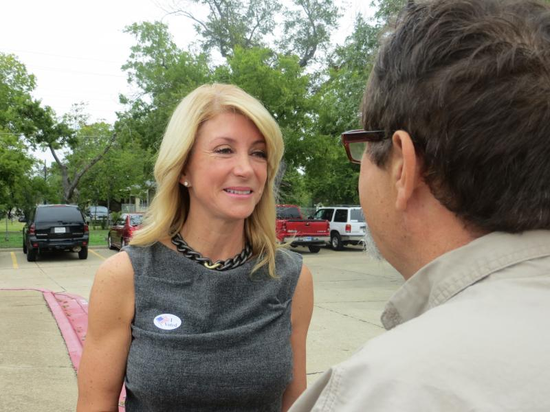 Sen. Wendy Davis talked to voters after casting her early ballot Monday.