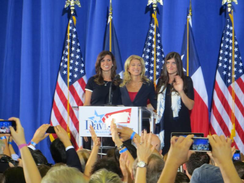 Sen. Davis on stage with daughters Amber and Dru.