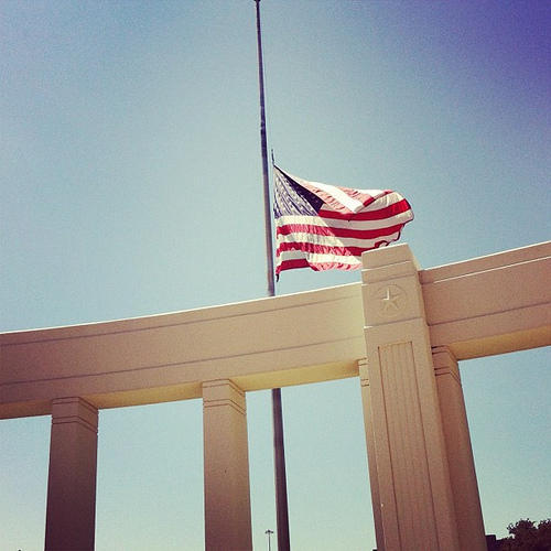 This flag in Dealey Plaza, where JFK was assassinated, still flies at half-mast.
