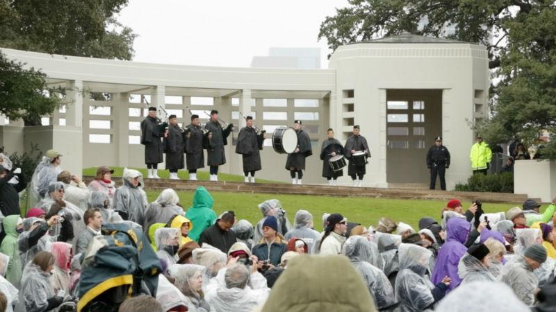Bagpipe players performed during the midday ceremony at Dealey Plaza.