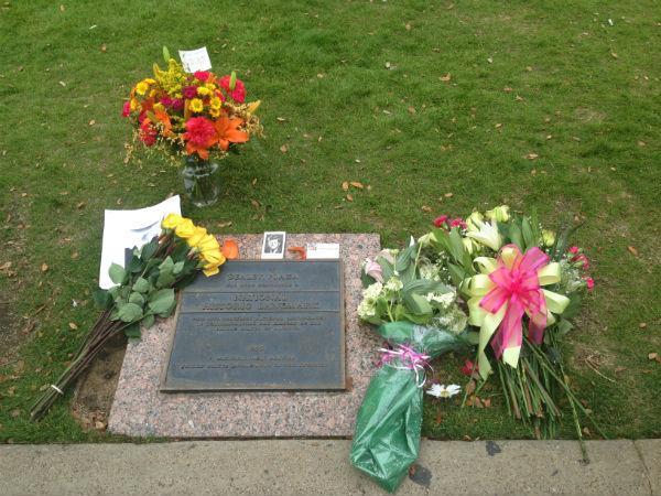 Visitors left flowers at Dealey Plaza Thursday.