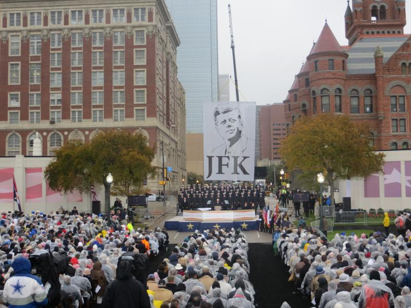 Most of the 5,000 with tickets braved cold, rainy weather to attend the JFK remembrance at Dallas' Dealey Plaza.