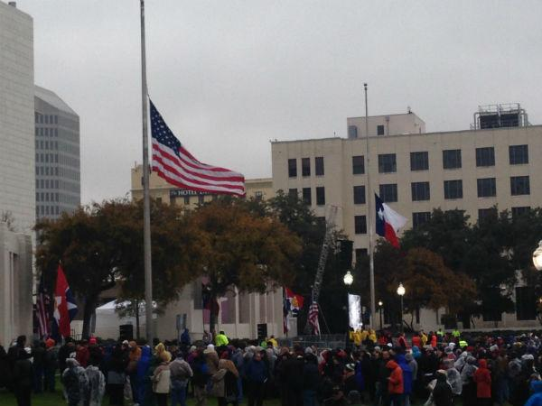 The Texas and American flags are at half-staff in Dealey Plaza.