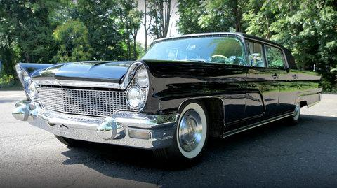 A black Classic 1960 Continental Mark V from President Kennedy's D.C. motor pool scored $210,000.