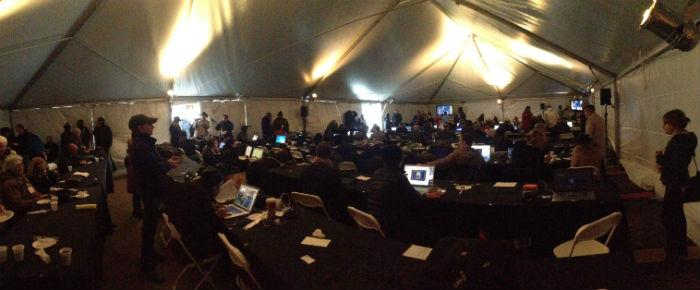 Media from around the world have gathered at Dealey Plaza. Many are filing stories from inside a large press tent.