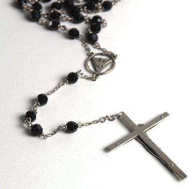 A rosary used by Kennedy was up for auction.