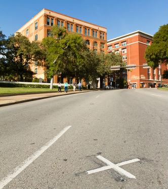 "The ""X,"" where President Kennedy was shot, has been removed from Dealey Plaza."