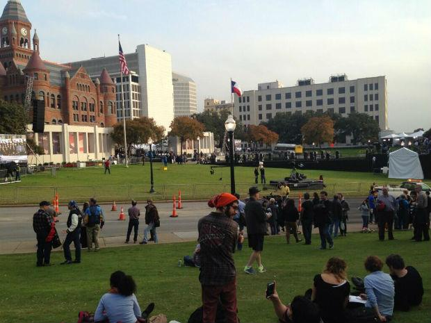 Scores of people have filled Dealey Plaza throughout the day Thursday. The plaza will be closed on Friday during the midday JFK ceremony.