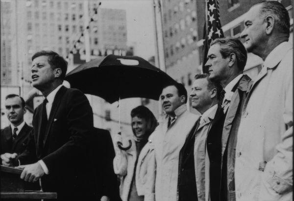 Lyndon Johnson, far right, looked on as President Kennedy spoke in Fort Worth. Johnson might not have had Kennedy's charm, but he had the power to persuade, the LBJ Library director says.