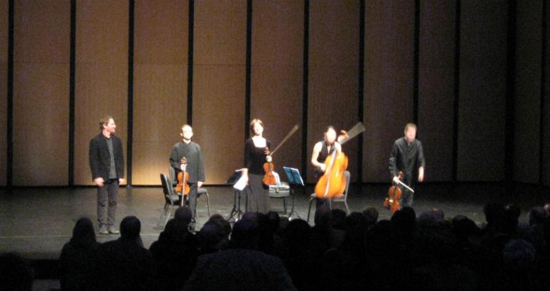 The composer of One Red Rose, Steven Mackey (far left), and the Brentano String Quartet take bows after Saturday's premiere in Dallas.