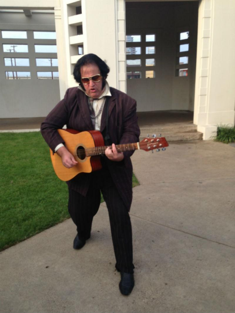 An Elvis impersonator serenaded the crowds Thursday afternoon.