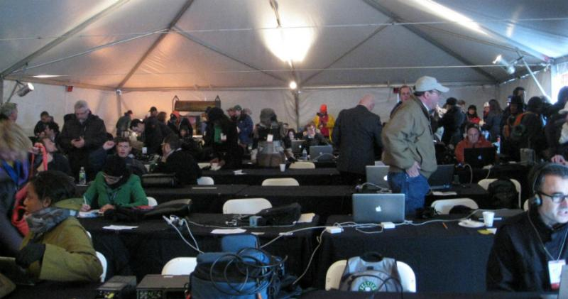 Local, national and international reporters in the 'filing tent' for the working media who covered Dallas' JFK 50th Memorial.