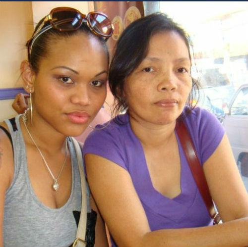 Since the typhoon, Kristal Abalos, left, has been trying to learn more about her mother, Lorna Abalos, who's in the Philippines and lives near one of the hardest-hit cities.